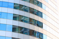 Glass wall of a skyscraper. Glass wall of a skyscraper for design business background in your work Stock Photos