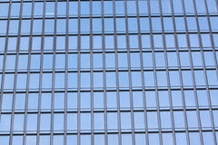 Glass wall of a skyscraper. Glass wall of a skyscraper for design business background in your work Royalty Free Stock Photos