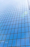 Glass wall of skyscraper. Mirror wall with sunshine royalty free stock image