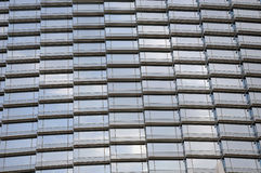 Glass wall of skyscrapper. With light reflection of sky Stock Images