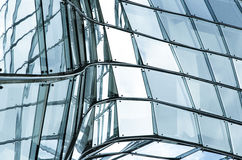 Glass wall. With steel construction of skyscraper. Abstract background with irregular shapes Stock Photos