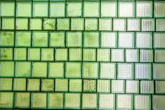 Glass wall with windows in retro style, background of those times. Tile glass, tiles are translucent, wall glass royalty free stock photography
