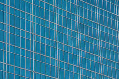 Glass wall of windows on a skyscraper Stock Images