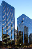 Glass walls. Two office tower in down town core by night Royalty Free Stock Photos