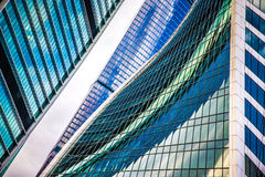 Glass walls of the building Moscow City with reflections. A lot. Of glass and concrete in modern architecture. Toned Royalty Free Stock Photos