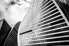 Glass walls of the building Moscow City with reflections. A lot. Of glass and concrete in modern architecture. Toned Royalty Free Stock Photo