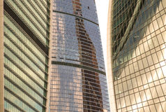 Glass walls of the building Moscow City with reflections. A lot. Of glass and concrete in modern architecture. Toned Royalty Free Stock Image
