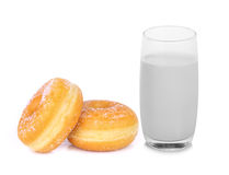 Glass of warm milk and sugar donut isolated on white. Background Stock Photos