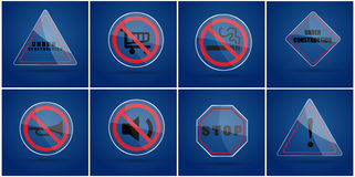 Glass warning sign ,no smoking sign,under construction sign,silence sign,stop sign Stock Photos