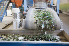 Glass waste in recycling facility. Glass particles. Glass particles for recycling in a machine in a recycling facility. Different glass packaging bottle waste Stock Photo