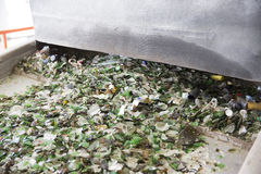 Glass waste in recycling facility. Glass particles in a machine Royalty Free Stock Photo