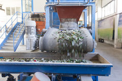 Glass waste in recycling facility. Glass particles. Glass particles for recycling in a machine in a recycling facility. Different glass packaging bottle waste Stock Image