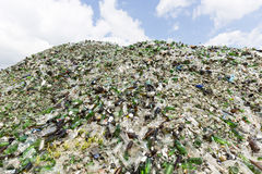 Glass waste in recycling facility. Pile of bottles. Stock Photos