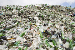 Glass waste in recycling facility. Pile of bottles. Stock Images
