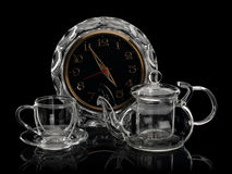 Glass watch, cup and teapot Royalty Free Stock Photo