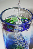 Glass of Water. Colorful Glass of Water with water pouring into it Royalty Free Stock Image