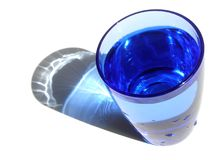 Glass of water. Isolated blue glass of water stock photo