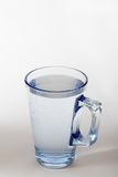 Glass of water. On white background Royalty Free Stock Photography