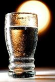 Glass water. With hard sun like background Stock Photo