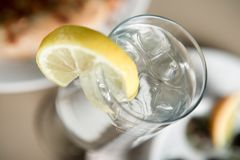 Glass of water. And lemon Stock Photography