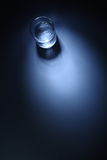 A glass of water. In a dark blue background Stock Image