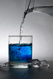 Glass of water. Water being poured into glass Stock Photo