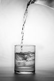 Glass of water. Water being poured into glass Royalty Free Stock Image