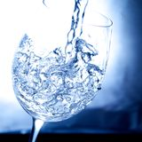 Glass of water. Splashing water in a glass Stock Photos