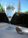 Glass of Water. Wine glass of water, with fork, spoon and napkin stock photos