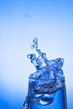 Glass and water Stock Images