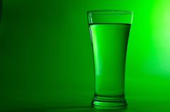 Glass of water. Glass with water on white background on green background Stock Photography