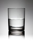 Glass of water. Half full glass of water Stock Photo