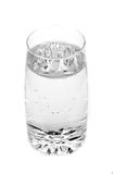 Glass with water. On white background Royalty Free Stock Image
