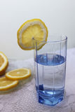 Glass of water. With lemons on white cloth Royalty Free Stock Photography