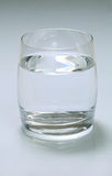 Glass of water. In a white background Royalty Free Stock Photos