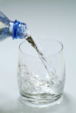 Glass of water. Pouring water in a glass Royalty Free Stock Photography