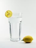 Glass of water. Glas of pure water with lemon isolated Royalty Free Stock Photo