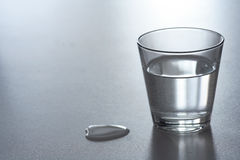 Glass water. Glass of water with large drop Royalty Free Stock Images