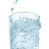 A glass of water. Water being poured into a glass Royalty Free Stock Photos