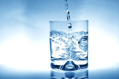 Glass of water. For refreshment in summer or at a party Royalty Free Stock Images