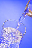 Glass of water. Water being poured from a pitcher into a glass royalty free illustration