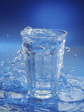 Glass of water. Studi shot of water splashing from the glass Royalty Free Stock Photos