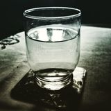 Glass water. Artistic look in duotone style. Stock Photos