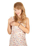 Glass of water and attractive girl Royalty Free Stock Image