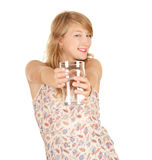 Glass of water and attractive girl Stock Photos