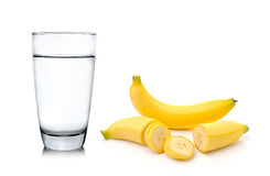 Glass of water and banana  on white background Royalty Free Stock Image