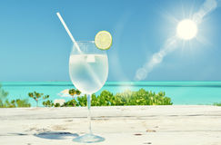 Glass of water on the beach Stock Photos