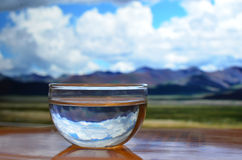 Glass of water in a beautiful day Royalty Free Stock Images