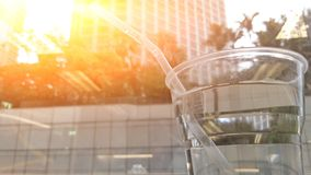 Glass of water besides window in sunshine. Pulled pork burger bite mark food lunch fast yummy carb fat convenience spicy hot glass water morrning breakefast royalty free stock photo