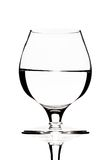 Glass of water on a black royalty free stock photos